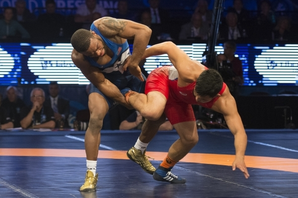U.S. wrestler Jordan Burroughs takes a gold medal against Mongolia's Unurbat Purevjav in the  74KG men's freestyle during the Wrestling World Championships at Orleans Arena in Las Vega ...