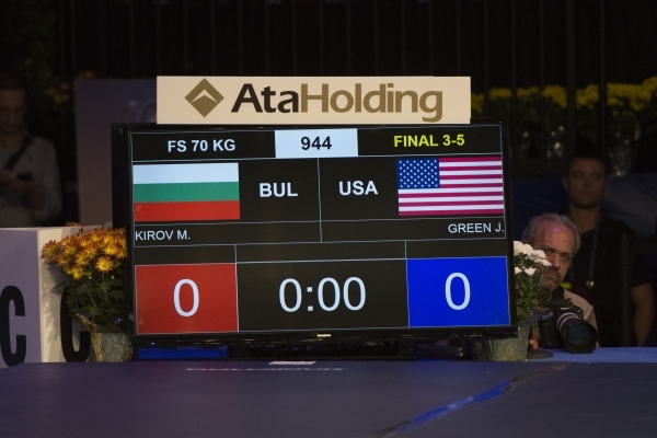 The scoreboard is shown prior to U.S. wrestler James Green taking a bronze medal victory against Bulgaria's Petar Kirov in the men's freestyle at the Wrestling World Championships at O ...