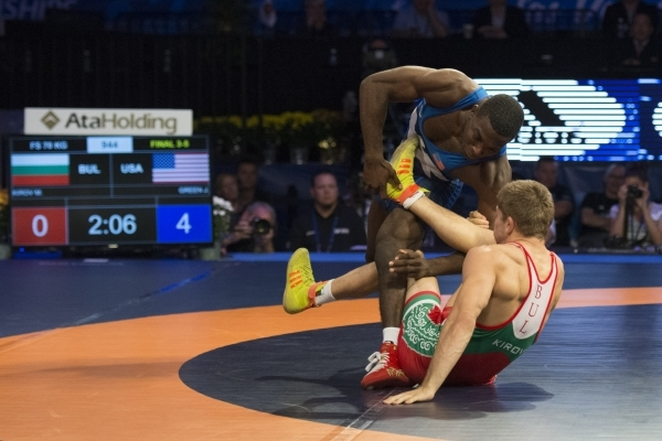 U.S. wrestler James Green takes a bronze medal in a victory against Bulgaria's Petar Kirov in the 70KG men's freestyle during the Wrestling World Championships at Orleans Arena in Las  ...