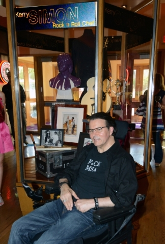 Kerry Simon, dubbed the ìrock ëní roll chefî by Rolling Stone magazine, is honored with the inaugural culinary memorabilia case at Hard Rock Hotel & Casino in Las Vegas on Thursday ...