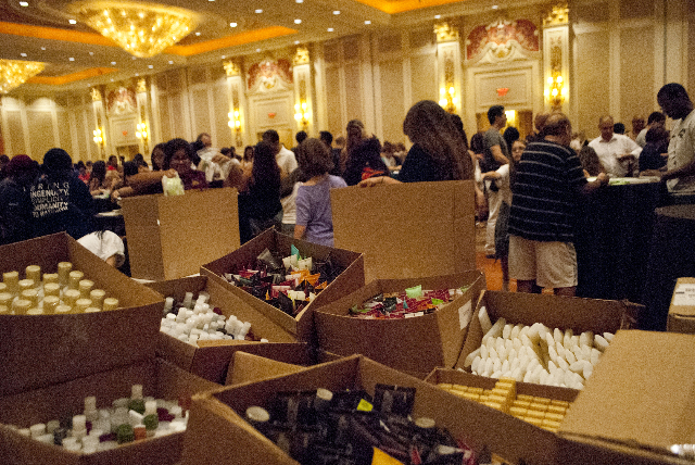 Various bottles of soap, shampoo and other toiletries are stacked in boxes, ready to be turned into hygiene kits during an event run by Clean the World inside the Sands Expo and Convention Center  ...