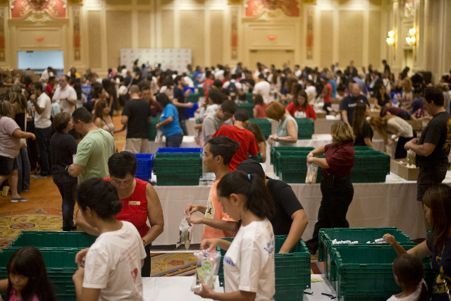 Hundreds of volunteers create hygiene kits during an event run by Clean the World inside the Sands Expo and Convention Center on the Strip poised to build 200,000 hygiene kits for the homeless on  ...