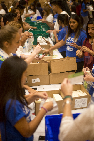 Students from East Tech High School help to create hygiene kits during an event run by Clean the World inside the Sands Expo and Convention Center on the Strip poised to build 200,000 hygiene kits ...
