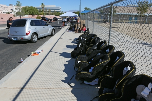 New car seats line a fence at a National Seat Check Saturday near Katz Elementary School Saturday, Sept. 19, 2015, in Las Vegas. CCSD police officers along with UMC Trauma and UMC Childrenís Ho ...