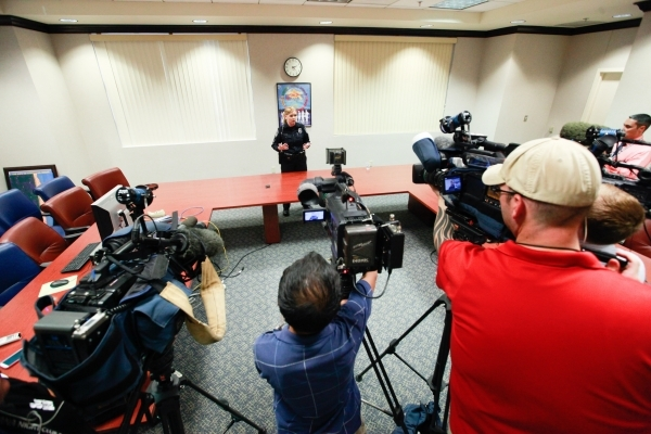 North Las Vegas police Sgt. Chrissie Coon addresses media about about the murder charge for 16-year-old Patrick Wayne Harper being dropped at the North Las Vegas Municipal Court building in North  ...