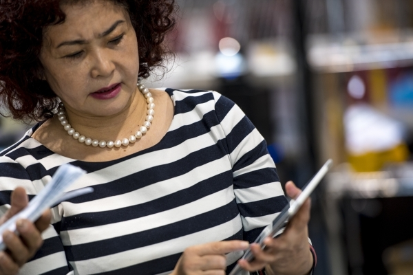 Ping Gao looks on her iPad at Rechargeable Power Energy in Las Vegas on Tuesday, Sept. 15, 2015. Ping is the chairwoman of the Lithium Battery Association of China. Joshua Dahl/Las Vegas Review-Jo ...