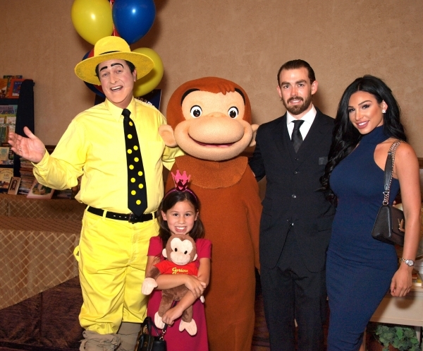 """The Man in the Yellow Hat"" Ted, (Christian Kolberg), from left,  Ava Vivanco 5, Curious George, (Georgina Martinez), Ryan Draney, and Krystiana Goodwin"