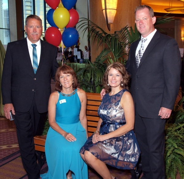 Charlie and Cindy Hensel, from left, and Carrie and Eric Buck