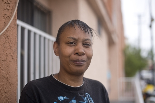 Shanetta Gilmer poses for a photograph in front of Parsons Place, a transitional housing complex where she lives, in downtown Las Vegas on Tuesday, Sept. 15, 2015. Gilmer is concerned about how th ...
