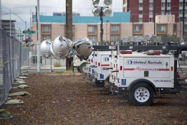 Equipment sits behind temporary fencing in downtown Las Vegas on Tuesday, Sept. 15, 2015, in preparation for the annual Life is Beautiful Music and Art Festival. The festival begins on Sept. 25, a ...