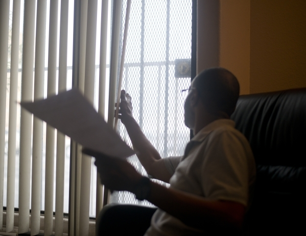 Bryiant (cq) Williams, Program Director at Parsons Place, a transitional housing complex in downtown Las Vegas, sits in his office on Tuesday, Sept. 15, 2015. Williams is concerned about how the L ...