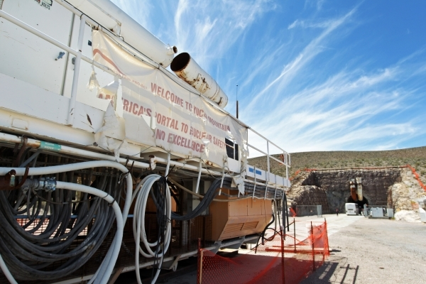 """A tattered sign proclaiming Yucca Mountain as """"America's Portal to Nuclear Safety and Excellence"""" is seen outside the south portal during a congressional tour of the Yucca Mountain ..."""