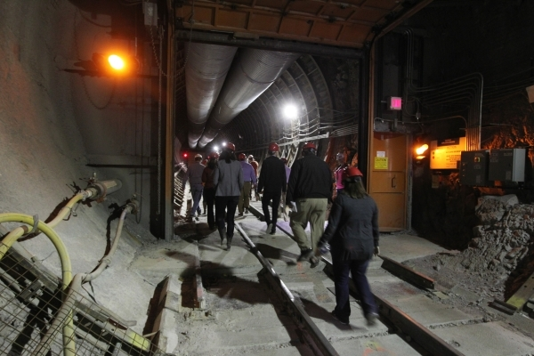 Congressional staff, journalists and Department of Energy employees exit the south portal during a tour of the Yucca Mountain exploratory tunnel Thursday, April 9, 2015. Sam Morris/Las Vegas Revie ...