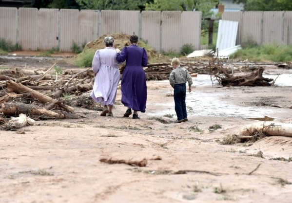 12 confirmed dead after flash flooding in small Utah-Arizona community