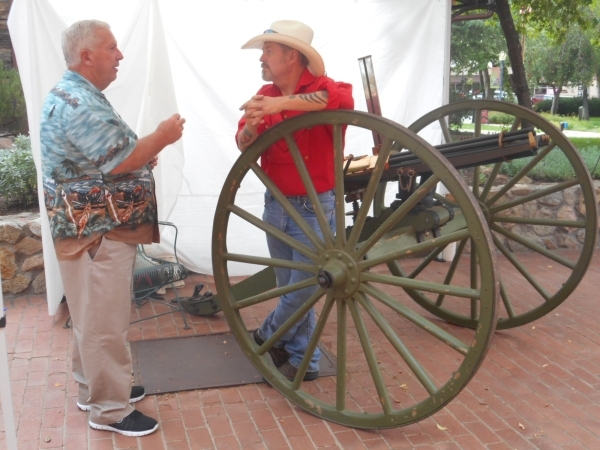 Prescott native James Jones, a member of the The Arizona Rough Riders Spanish-American War-era reenactment group, takes a tourist'­s questions about his working replica Gatling Gun at the S ...