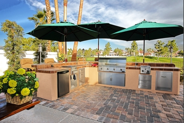 Outdoor kitchens are the gathering places for guests. COURTESY  PHOTO