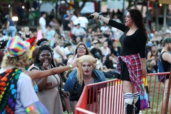 Jessenia Paz, right, singer for Empire Records All 90's Experience, performs during the Pride Festival outside of the Clark County Government Center in Las Vegas Saturday, Sept. 19, 2015. ER ...