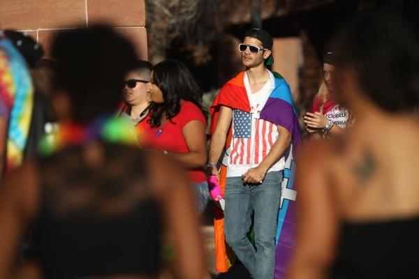 Trey Donato, center, walks with friends during the Pride Festival outside of the Clark County Government Center in Las Vegas Saturday, Sept. 19, 2015. ERIK VERDUZCO/LAS VEGAS REVIEW-JOURNAL Follow ...