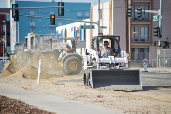 Workers spread dirt on 7th Street near Stewart Avenue in preparation for the Life is Beautiful Music and Art Festival in downtown Las Vegas on Wednesday, Sept. 16, 2015. The annual festival runs S ...