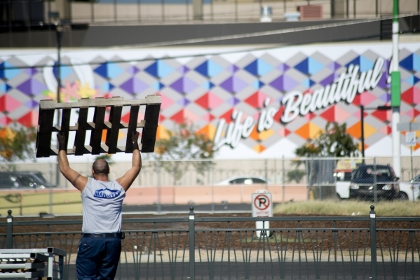 A worker carries a wooden pallet during preparations for the Life is Beautiful Music and Art Festival in downtown Las Vegas. The annual festival runs Sept. 25-27. Daniel Clark/Las Vegas Review-Journal