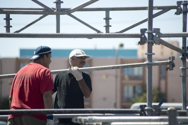 Workers construct the main stage during preparations for the Life is Beautiful Music and Art Festival in downtown Las Vegas on Wednesday, Sept. 16, 2015. The annual festival runs Sept. 25-27. Dani ...
