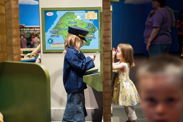 "A costumed conductor sells a ticket to a prospective passenger bound for adventure in ""Thomas & Friends: Explore the Rails,"" a touring exhibit opening Saturday at the Discovery Child ..."