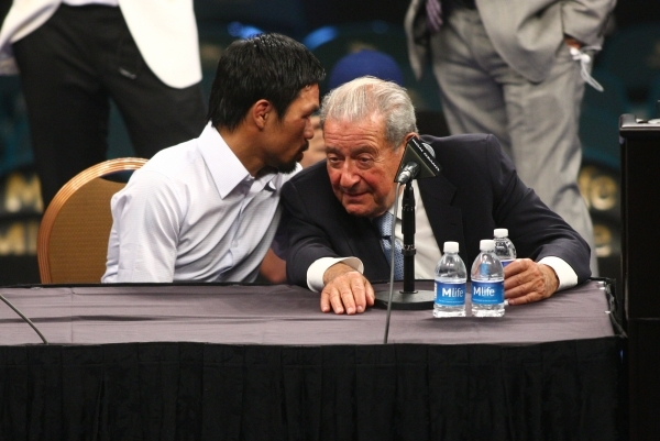 Manny Pacquiao, left, talks with promoter Bob Arum following Pacquiao's defeat by Floyd Mayweather Jr. after their welterweight unification boxing match at the MGM Grand Garden Arena in Las  ...