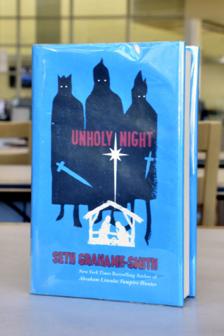 ìUnholy Nightî is shown at the Windmill Library on Friday, Sept. 18, 2015. It is one of the books at the library that some patrons felt contained objectionable content. Bill Hughes/Las Vegas ...