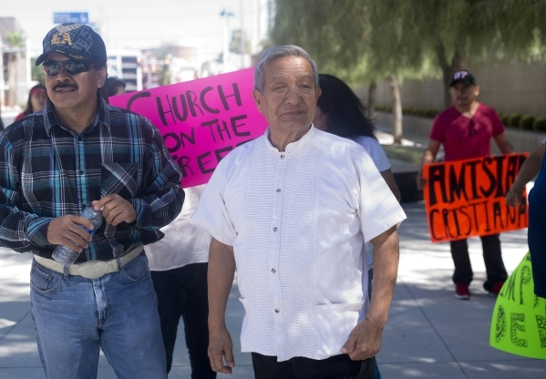 Victor Heredia, left, and Amistad Christiana church pastor Joel Menchaca stand outside the Lloyd George Federal Courthouse after a hearing in downtown Las Vegas on Thursday, Sept. 17, 2015. The ch ...