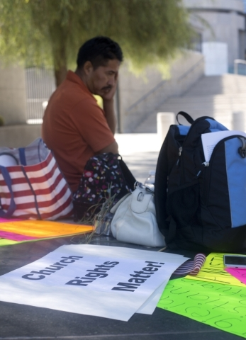 Aristeo Santiago, a member of  Amistad Christiana church, waits for news from his pastor outside the Lloyd George Federal Courthouse in downtown Las Vegas on Thursday, Sept. 17, 2015. The church i ...