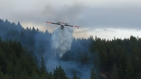 A plane drops water on a small fire near Spooner Lake on the east side of Lake Tahoe on Wednesday, Sept. 16, 2015. The 1/4-acre fire was extinguished. Courtesy, Tahoe Douglas Fire Protection District