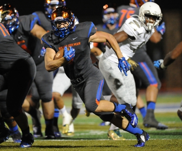 Bishop Gorman running back Biaggio Walsh (7) rushes the ball for a first down in the first half against Long Beach Poly at Bishop Gorman High School in Las Vegas Friday, Sept. 18 2015. Josh Holmbe ...