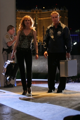 Catherine (Marg Helgenberger) and Grissom (William Petersen) investigate the murder of an aspiring dancer killed backstage at a Cirque du Soleil in the seventh season premiere. (Robert Voets/CBS)