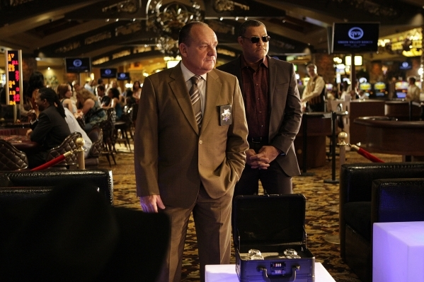 Captain Brass (Paul Guilfoyle, left) and Dr. Langston (Laurence Fishburne) are shown in a scenefilmed at Green Valley Ranch for the ninth season finale.(Sonja Flemming/CBS)