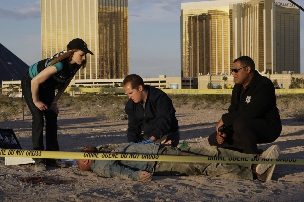 From left, Catherine (Marg Helgenberger), coroner David Phillips (David Berman) and Dr. Raymond Langston (Laurence Fishburne) investigate a body discoveed next to Mandalay Bay on the ninth season  ...
