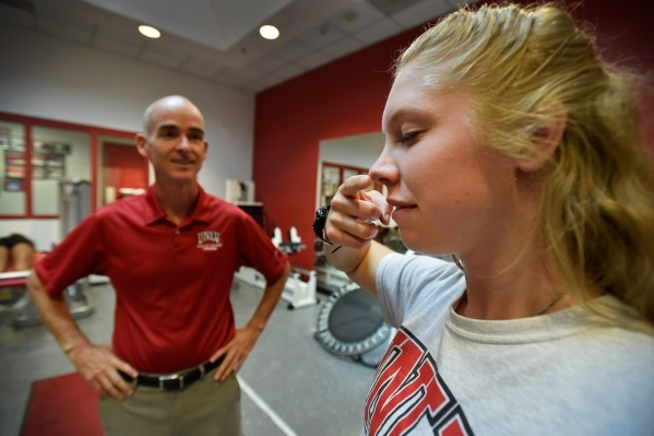 Athletic training student Serena Bruhn, right, receives a balance and coordination test during a demonstration with Tedd Girouard, UNLV's director of athletic training, at UNLV on Monday, Se ...