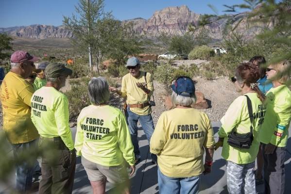 Organizer Doyle Wayman, center, of Friends of Red Rock Canyon speaks to volunteers before doing maintenance work at the visitor center inside Red Rock National Conservation Area in Las Vegas on Sa ...