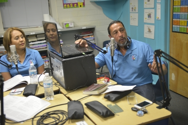 Yolanda and Javier Valdez record their radio show at St. Anne's Catholic Church in Las Vegas on Friday, Sept. 18, 2015. Their family plans to visit Philadelphia and Washington, D.C., to atte ...