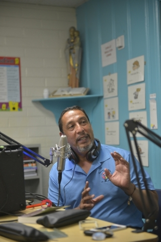 Javier Valdez prepares to record his radio show at St. Anne's Catholic Church in Las Vegas on Friday, Sept. 18, 2015. Valdez and his family plan to visit Philadelphia and Washington, D.C., t ...