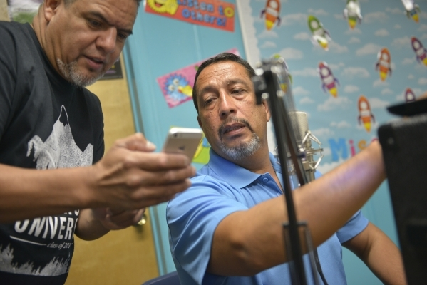 Samuel Torres, left, and Javier Valdez prepare to record their radio show at St. Anne's Catholic Church in Las Vegas on Friday, Sept. 18, 2015. Valdez and his family plan to visit Philadelph ...