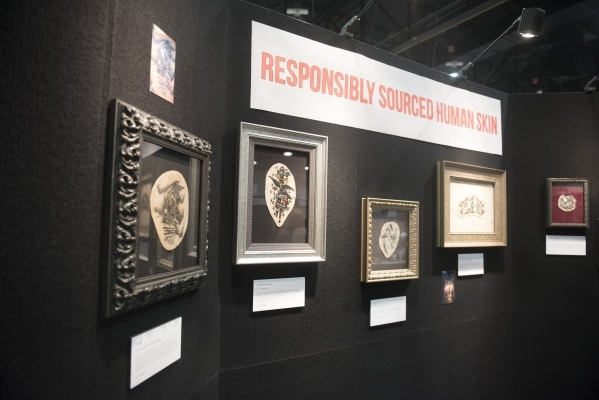 """Framed and preserved tattoos on real human skin are on display at the Nation Association for the Preservation of Skin Art booth at the """"Biggest Tattoo Show on Earth"""" at the Las Vegas Con ..."""