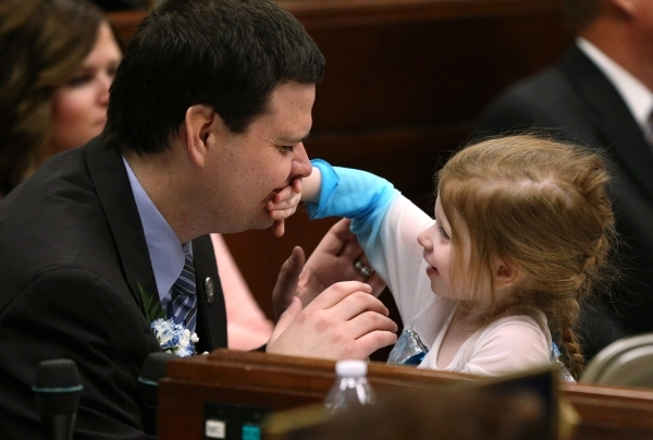 Nevada Assemblyman David Gardner, R-Las Vegas, plays with his daughter Bella following  opening day ceremonies at the Legislative Building in Carson City, Nev., on Monday, Feb. 2, 2015. (Cathleen  ...