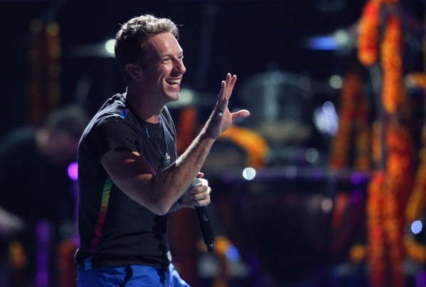 Chris Martin of Coldplay performs during the iHeartradio Music Festival at the MGM Grand Garden Arena in Las Vegas on Friday, Sept. 18, 2015. Chase Stevens/Las Vegas Review-Journal Follow @cssteve ...
