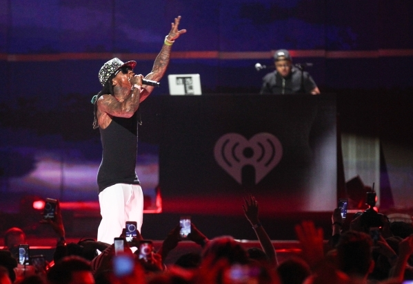 Lil Wayne performs during the iHeartRadio Music Festival at the MGM Grand Garden Arena in Las Vegas on Friday, Sept. 18, 2015. Chase Stevens/Las Vegas Review-Journal Follow @csstevensphoto