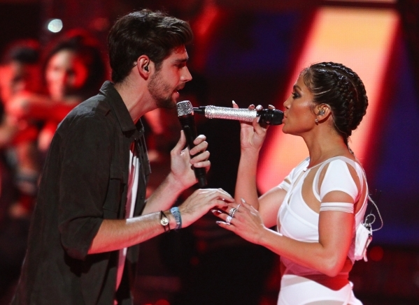 Jennifer Lopez, right, performs with Alvaro during the iHeartRadio Music Festival at the MGM Grand Garden Arena in Las Vegas on Saturday, Sept. 19, 2015. Chase Stevens/Las Vegas Review-Journal Fol ...