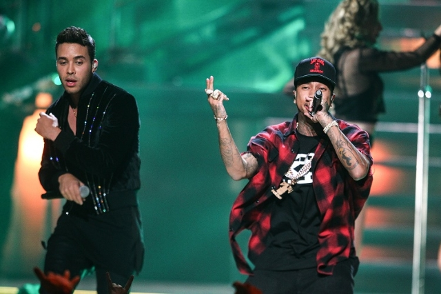 Prince Royce, left, and Tyga perform during the iHeartRadio Music Festival at the MGM Grand Garden Arena in Las Vegas on Saturday, Sept. 19, 2015. (Chase Stevens/Las Vegas Review-Journal) Follow @ ...
