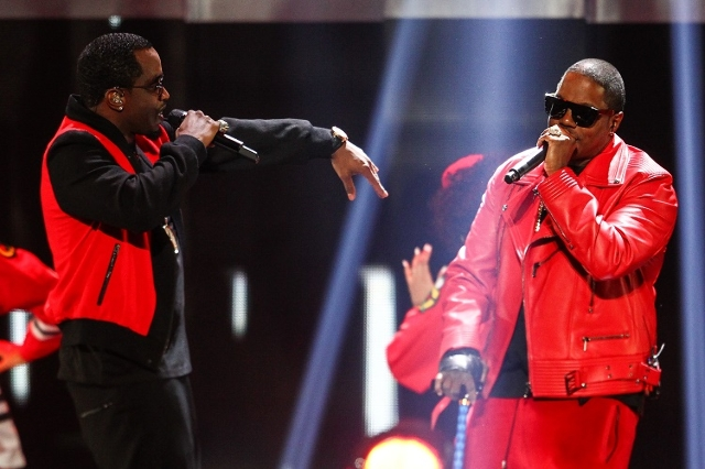 Puff Daddy, left, performs with Mase during the iHeartRadio Music Festival at the MGM Grand Garden Arena in Las Vegas on Saturday, Sept. 19, 2015. (Chase Stevens/Las Vegas Review-Journal) Follow @ ...