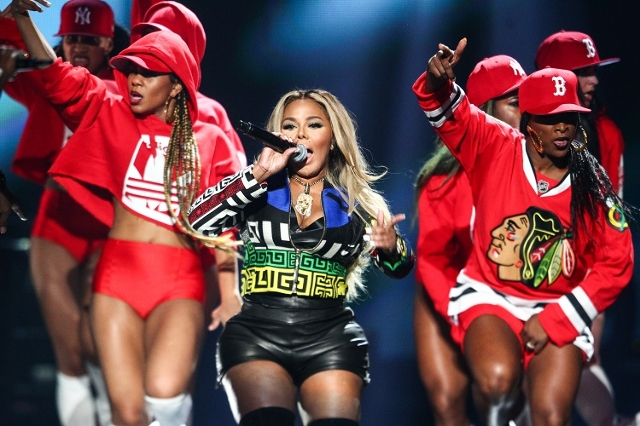 Lil' Kim performs with Puff Daddy, not pictured, during the iHeartRadio Music Festival at the MGM Grand Garden Arena in Las Vegas on Saturday, Sept. 19, 2015. Chase Stevens/Las Vegas Review- ...