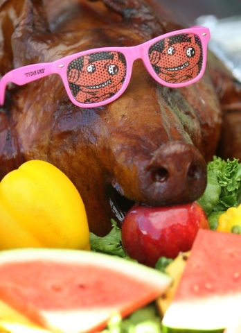 A whole pig called Pig D-licious, which was smoked for 20 hours and is slated to be cut into, is displayed at the Rollin Smoke Barbecue tent during the Pigs for Kids Barbecue Cook-Off and Festival ...