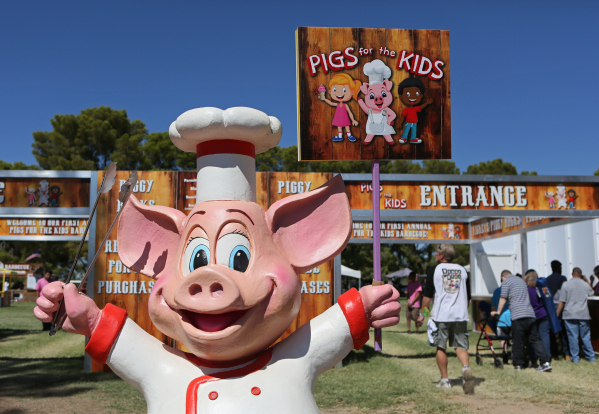 A pig statue is shown at the entrance to the Pigs for Kids Barbecue Cook-Off and Festival at Craig Ranch Regional Park Saturday, Sept. 19, 2015, in North Las Vegas. Ronda Churchill/Las Vegas Revie ...